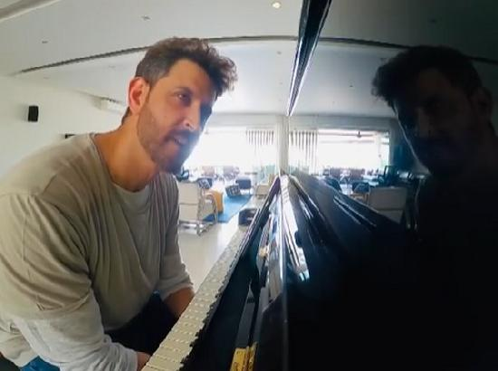Hrithik Roshan tries hand at piano in special video photobombed by Sussane Khan