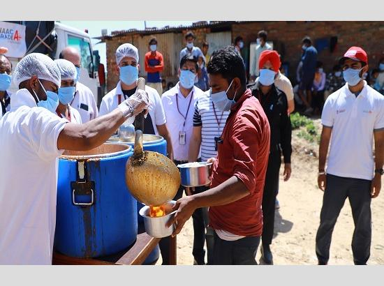 Coronavirus in India: Chandigarh University distributing food to poor & needy in nearby vi