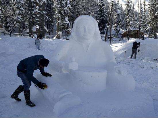 Gulmarg: A man makes makes a snow sculpture at a resort in Gulmarg of South Kashmir on Jan
