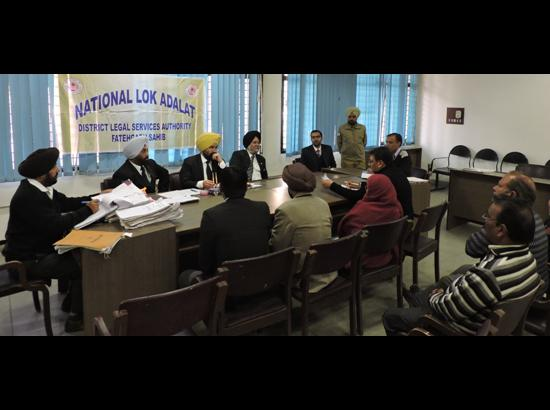 743 cases amicably settled in National Lok Adalat