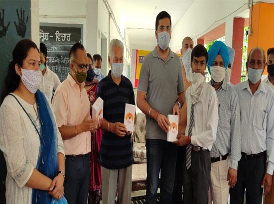MLA Angad Singh distributes Smart Phones to class 12th students at Rahon