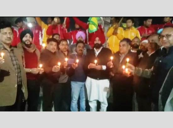 MLA Pinki joins children holding Candle March for farmers lost their lives during protest