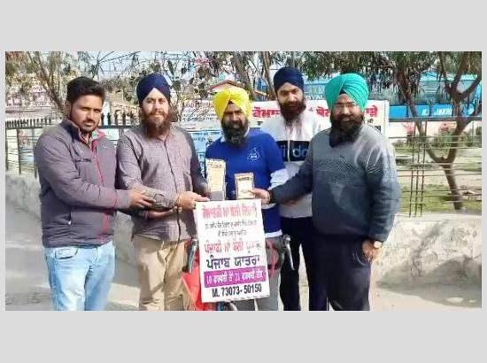 Mansa based youth Tejinder Singh pedalling across state to promote Punjabi